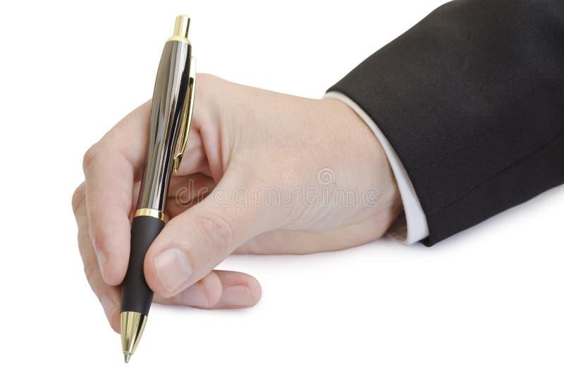 D'isolement écrivant la main avec le brun et le stylo d'or photographie stock