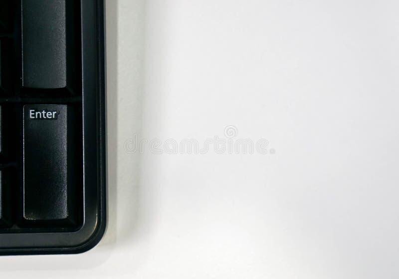D'isolement entrez dans le bouton sur le clavier d'ordinateur photographie stock libre de droits
