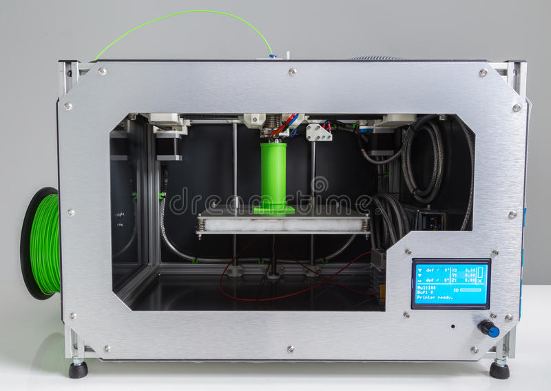 3d printer with bright green filament.  stock image