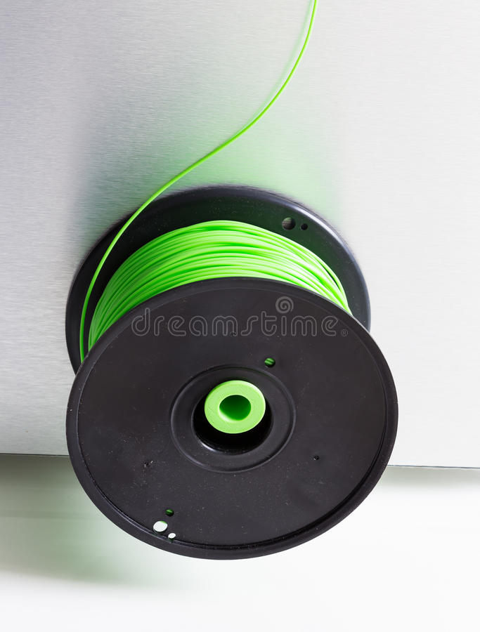3d printer with bright green filament.  royalty free stock image