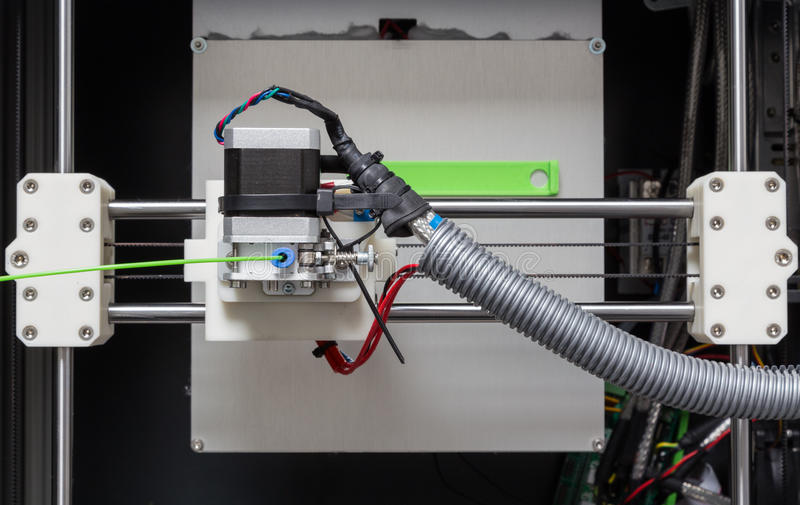 3d printer with bright green filament.  royalty free stock photography