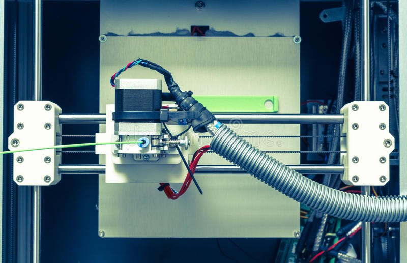 3d printer with bright green filament.  stock photo