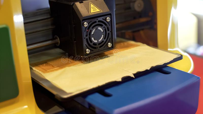 3d printer making component, innovative technologies in manufacturing, closeup royalty free stock image