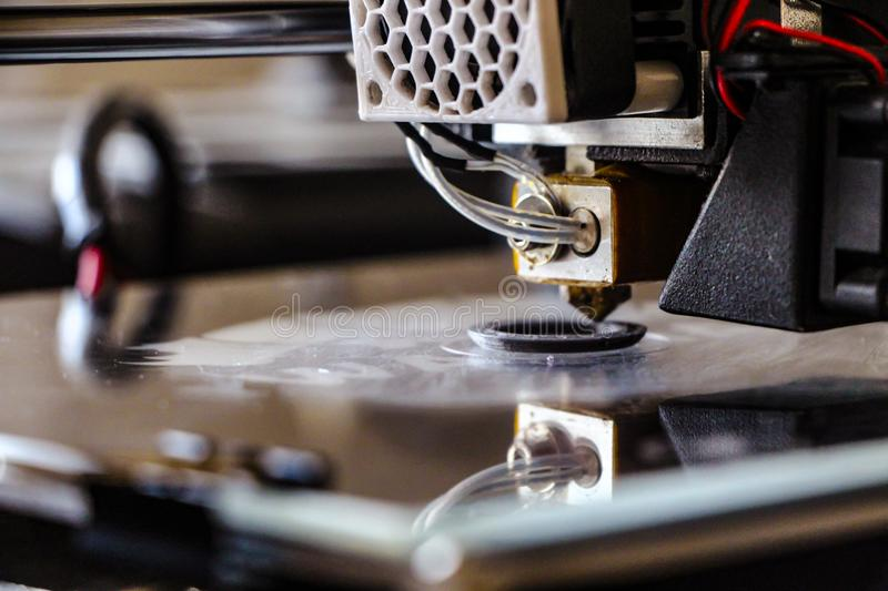 3d printer is printing. I took a photo a 3dprinter when it is printing royalty free stock images