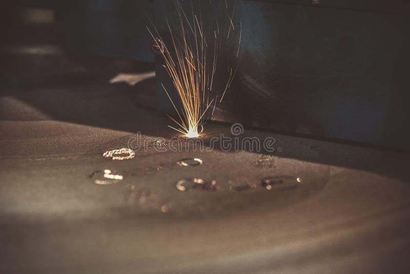 3D printer printing metal. Laser sintering machine for metal. Metal is sintered under the action of laser into shape. DMLS, SLM, SLS. Modern additive royalty free stock photos