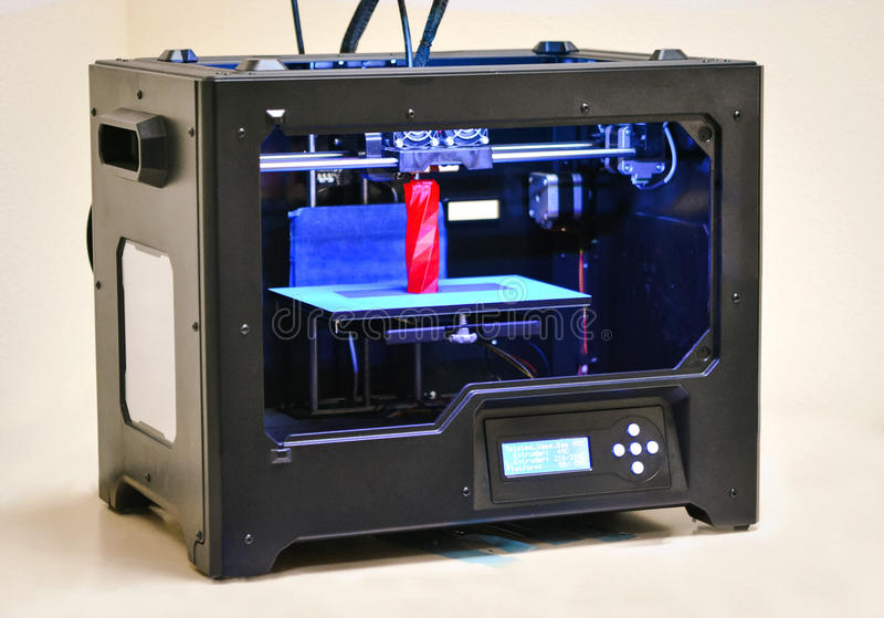 3D printer works and creates an object from the hot molten plastic. Close-up. Progressive modern additive technology. Concept of 4.0 industrial revolution royalty free stock photography