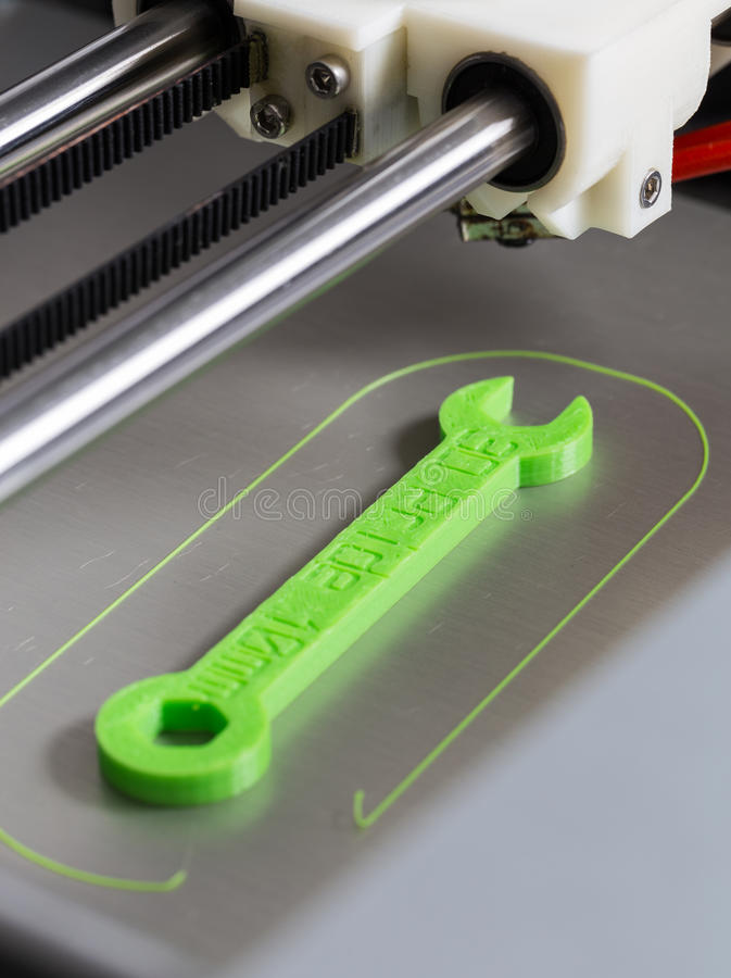 3d printing with light green filament.  royalty free stock photography