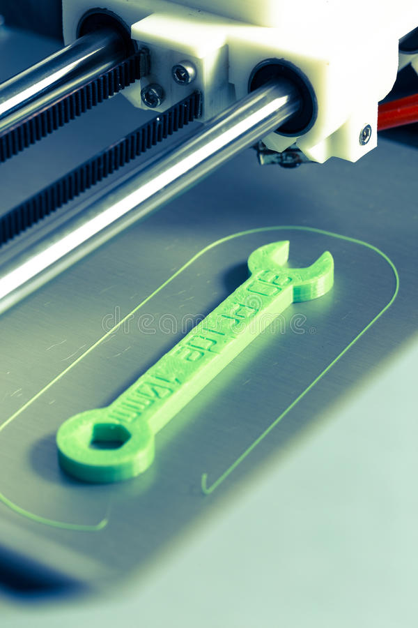 3d printing with light green filament.  stock images