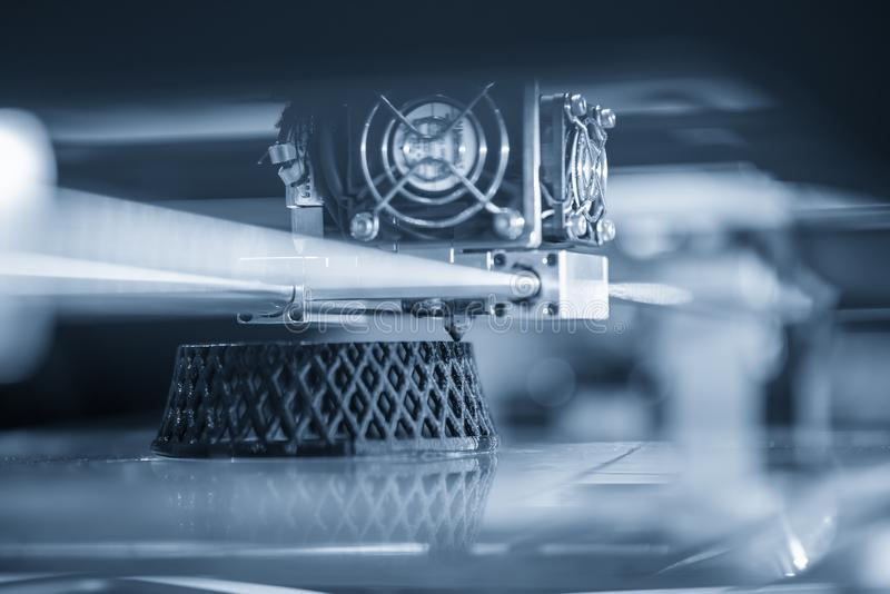 The 3D printing machine operation. The 3D rapid prototype processing concept royalty free stock image