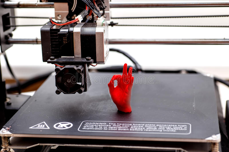 3d printing machine and printed item. printed palm red stock photo