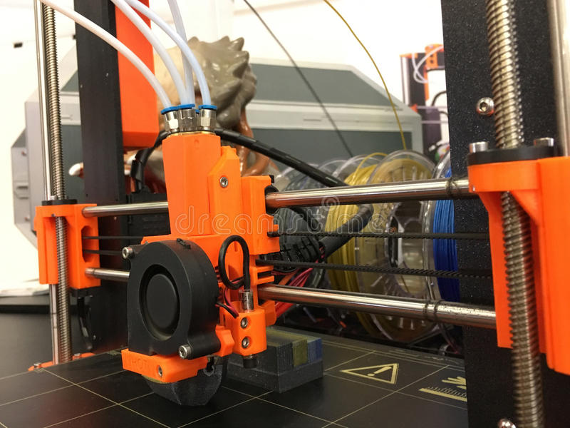 3D Printing Machine printing a piece of plastic. Working 3d printer royalty free stock photo