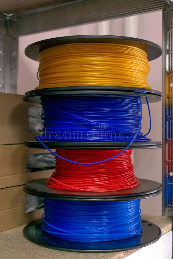 3D printing material, ABS filament, PLA & x28;Polylactic Acid& x29;,  PVA Filament.  Colored polymer in coils on the shelves. Printer, acrylonitrile, butadiene stock photos