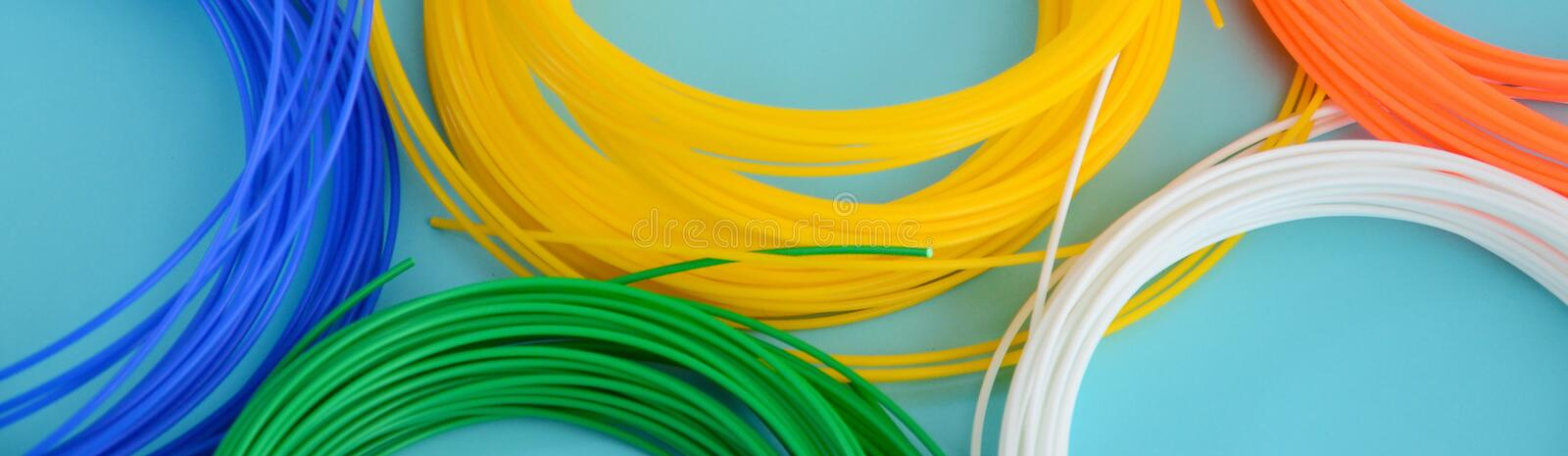 Plastic PLA and ABS filament material for printing on a 3D pen or printer of various colors stock photography