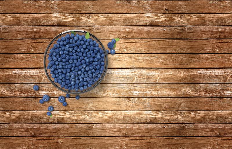 Glass bowl full of blueberries on wooden table royalty free stock image