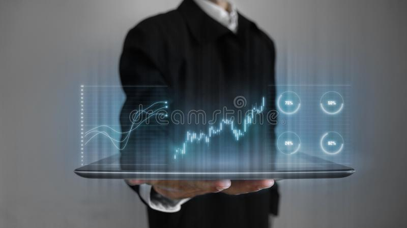 3D rendering of annual business performance report including stock candle stick, pie and line charts hologram hover over tablet. In a palm of business man royalty free stock image