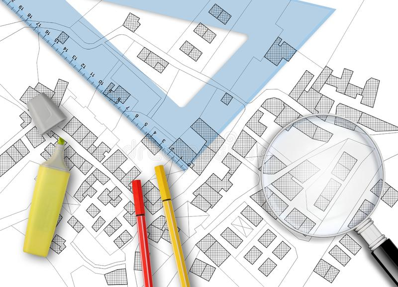 3D rendering of colored work tool over a cadastral map of territory with buildings, fields and roads - concept image stock photography