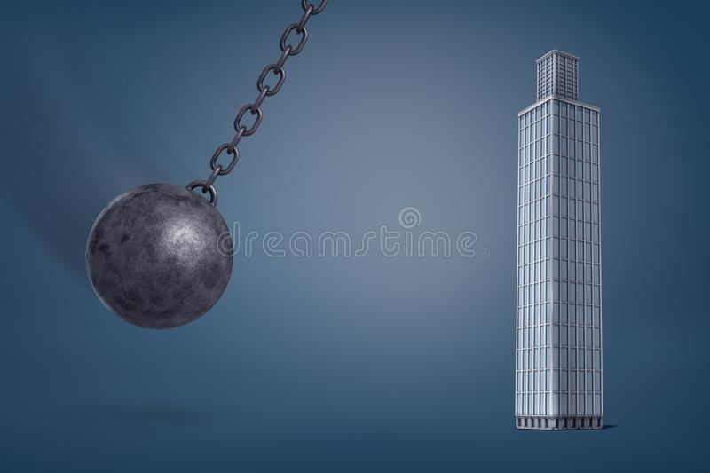 3d rendering of a giant iron wrecking ball swings on its chain in the direction of a tall glass skyscraper. royalty free stock images