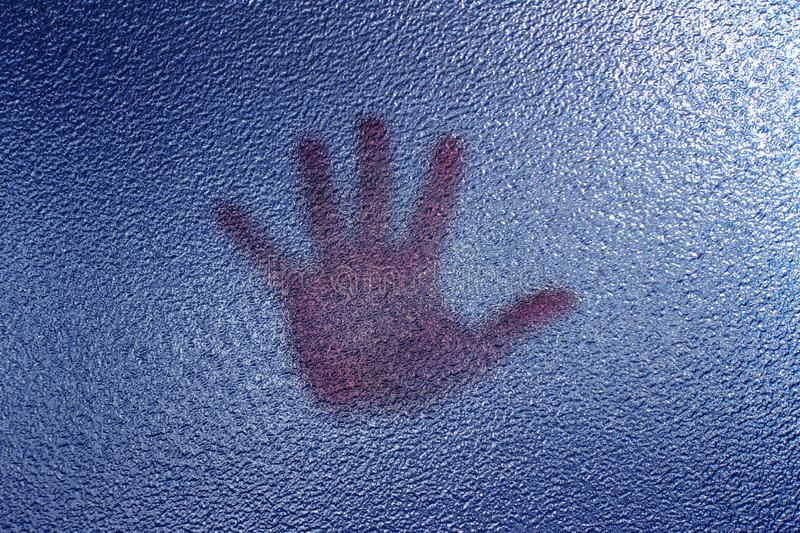 3d rendering Human palm leaning against the embossed glass in blue tones. Close up stock illustration