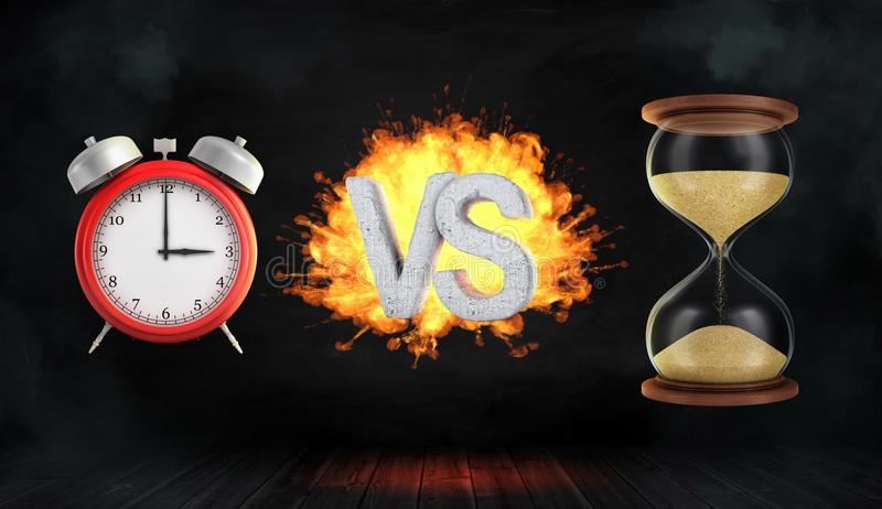 3d rendering a large flaming word VS stands between a red retro alarm clock and a hourglass. stock photo