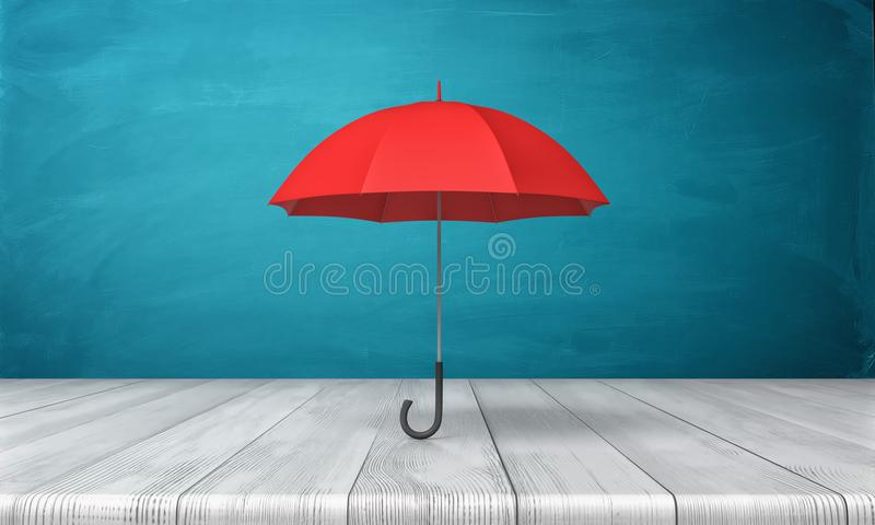 3d rendering of a single red classic umbrella with an open canopy standing above a wooden desk on blue background. royalty free illustration