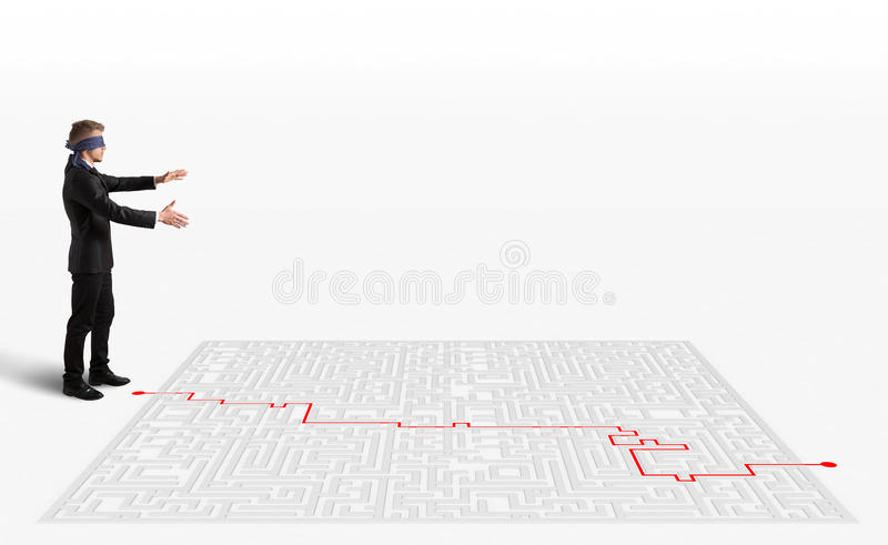 3D Rendering solution for the maze. 3D Rendering Hand draws and help a blindfolded businessman to way out of the maze stock images