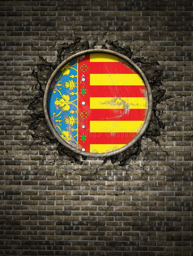 Old Valencia flag in brick wall stock images