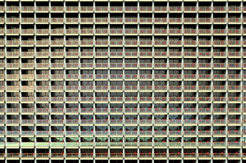 Uniformed looking apartments in a huge and overcrowded apartment building. 3D rendering of uniformed looking apartments in a huge and overcrowded apartment stock illustration