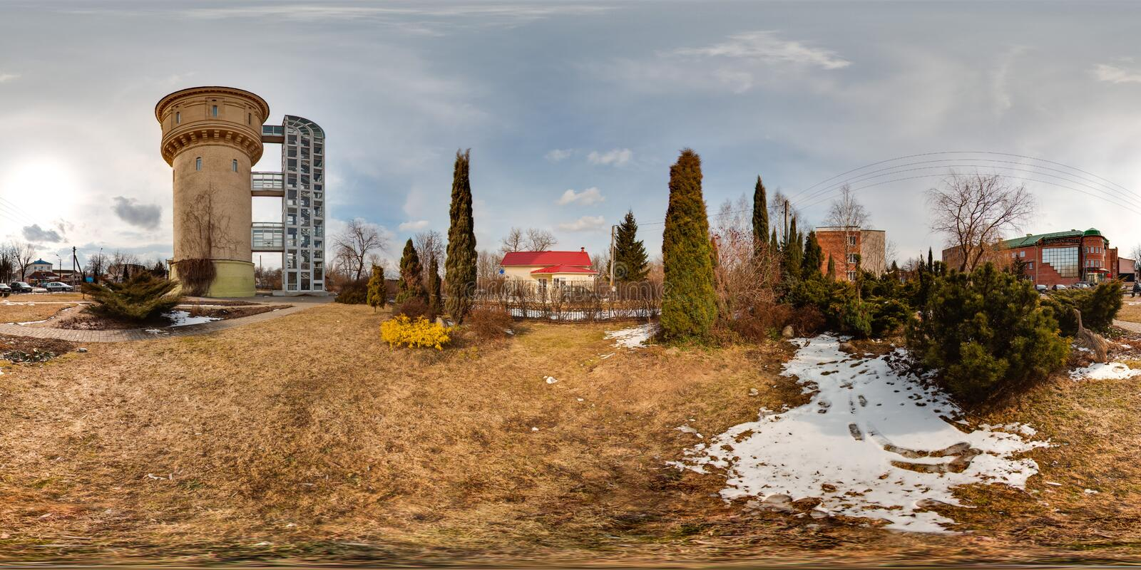 3D spherical panorama of landscape with snow, pines, water tower with 360 degree viewing angle. Ready for virtual reality in vr. stock image