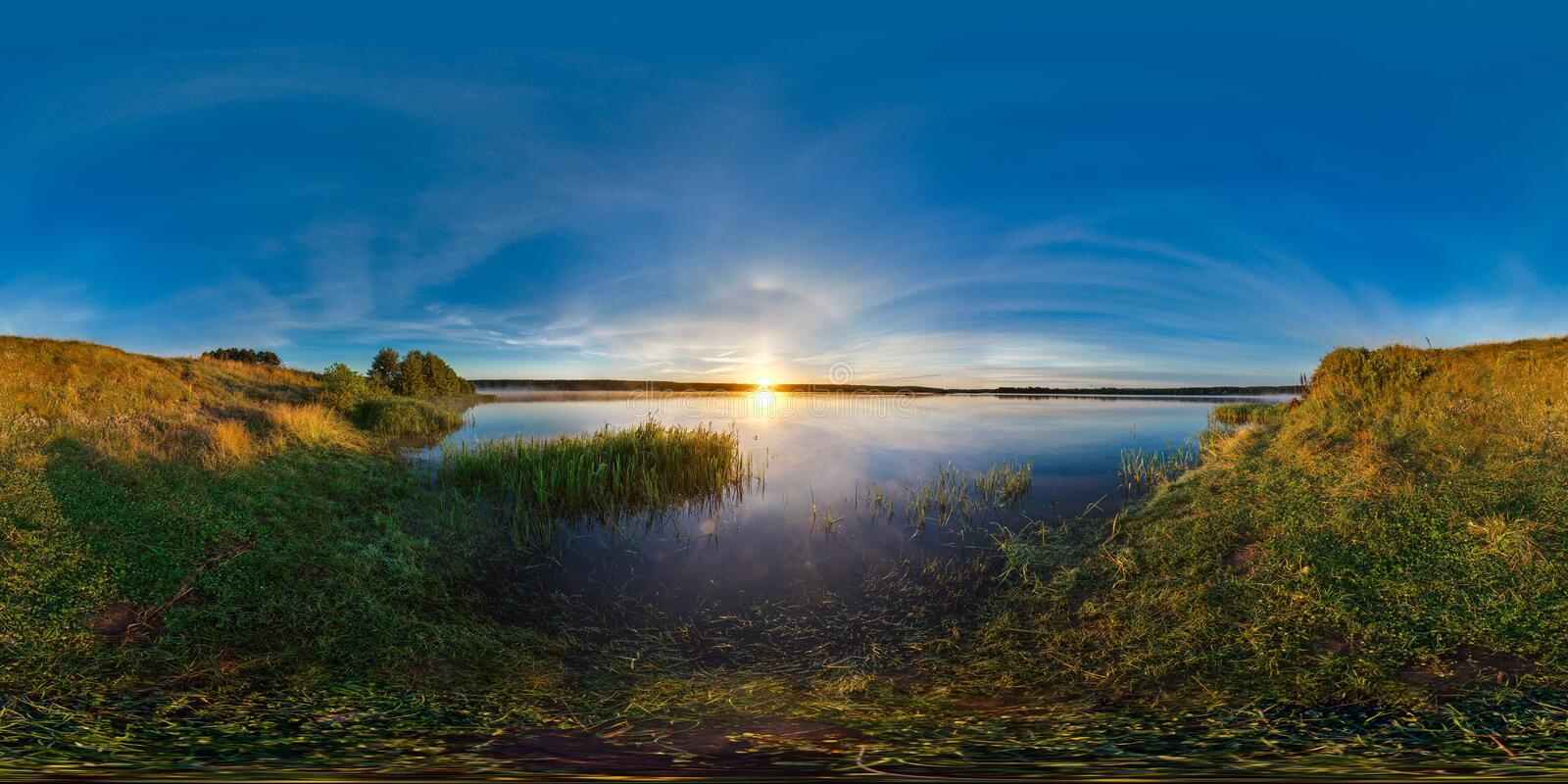 3D spherical panorama with 360 viewing angle. Ready for virtual reality or VR. Sunrise at the bank of lake. Deep blue sky. royalty free stock images