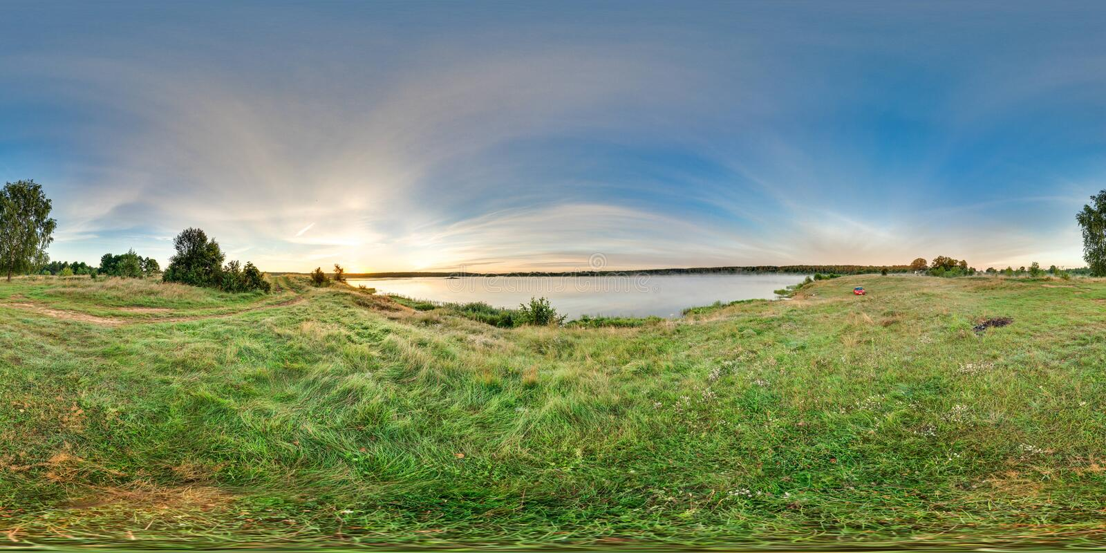 3D spherical panorama with 360 viewing angle. Ready for virtual reality or VR. Sunrise at the bank of lake. Fresh green. royalty free stock image
