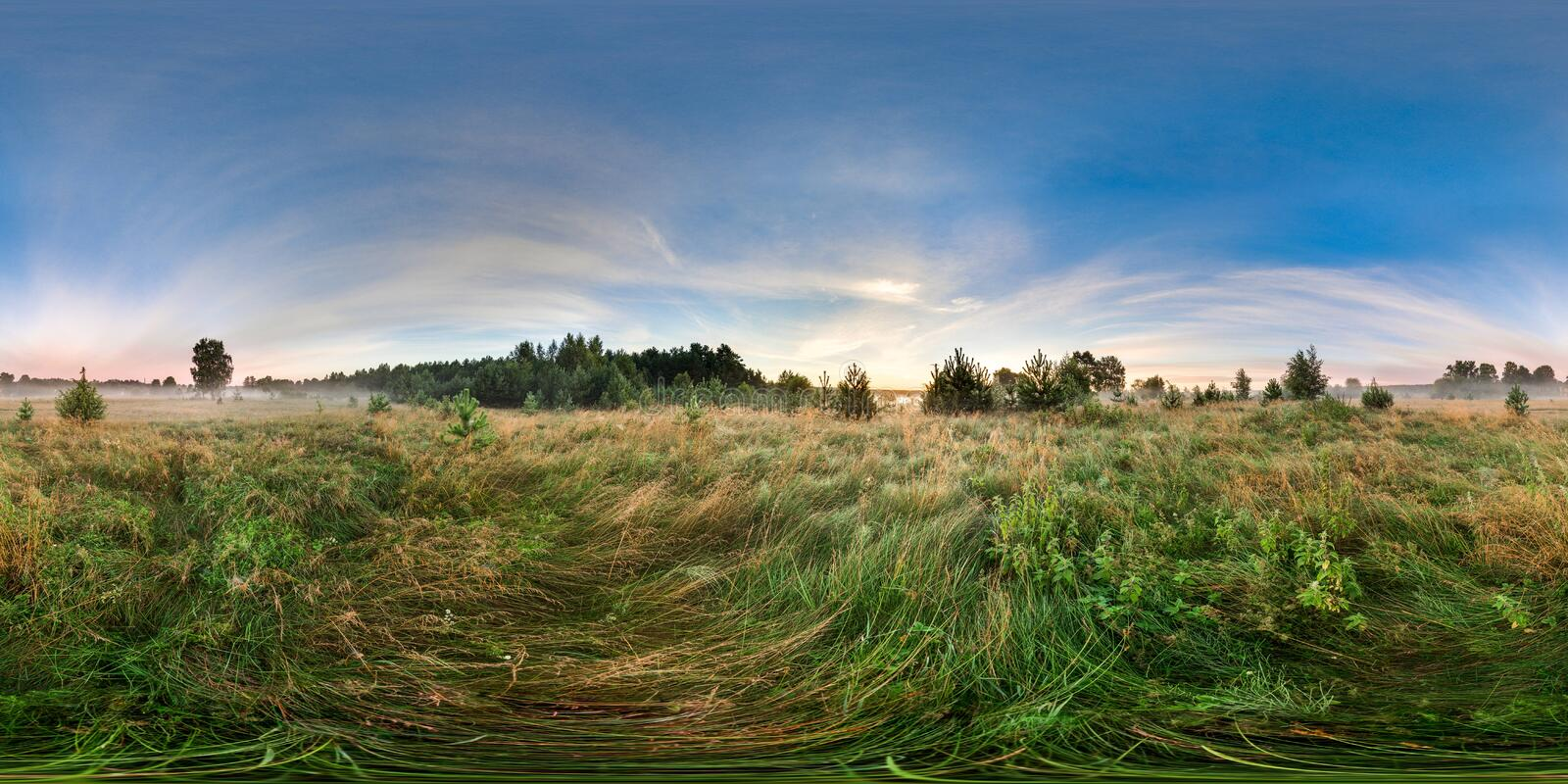 3D spherical panorama with 360 viewing angle. Ready for virtual reality or VR. Sunrise in the field. Little fog. royalty free stock photography