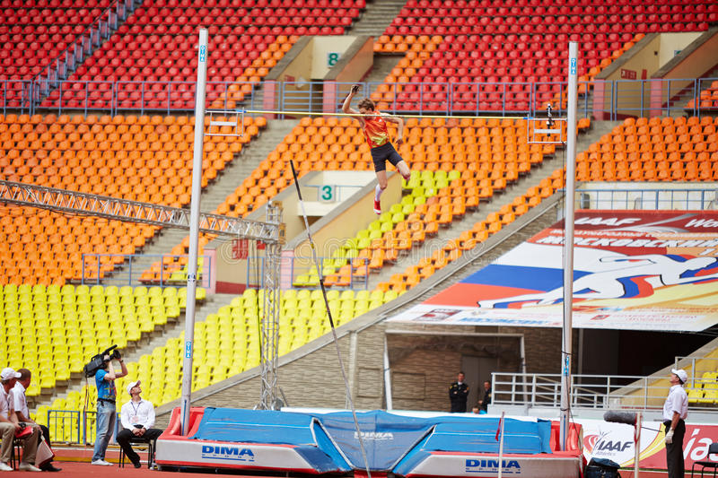 D.Starodubtsev goes over bar at Grand Sports Arena. MOSCOW - JUN 11: D.Starodubtsev goes over bar at Grand Sports Arena of Luzhniki OC during International stock photo