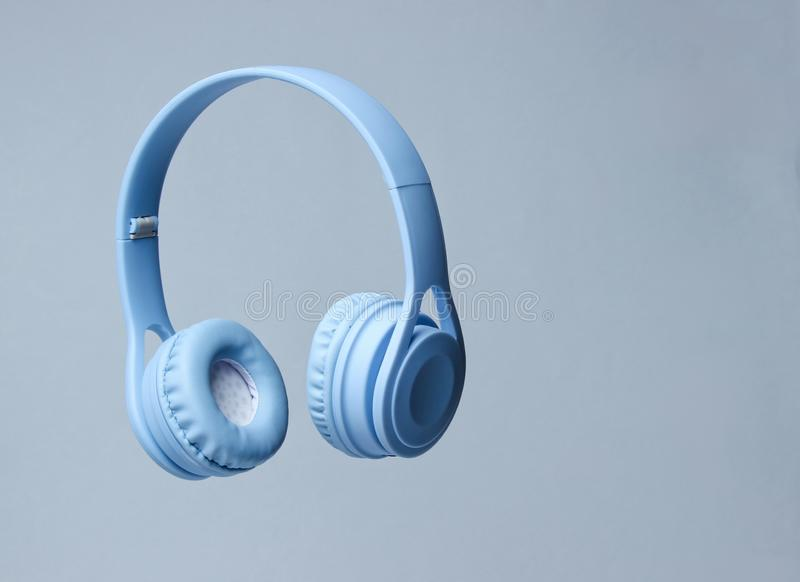 3D surround photo blue wireless headphones. On gray background royalty free stock images