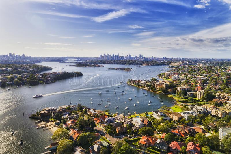 D Sy Drummoyne Rvr 2 CBD. Sydney inner west suburb Drummoyne and beyond on shores of Parramatta river flowing into Sydney harbour with distant city CBD on royalty free stock photo