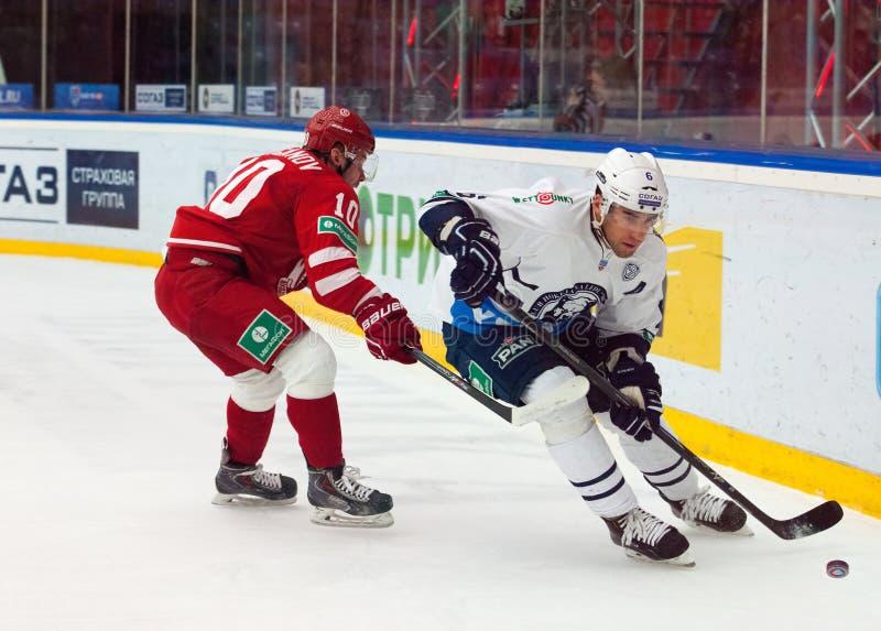 D. Tsyganov (10) vs M. Popovic (6). MOSCOW - JANUARY 10: D. Tsyganov (10) vs M. Popovic (6) on hockey game Vityaz vs Medvezchak on Russian KHL premier hockey stock photo
