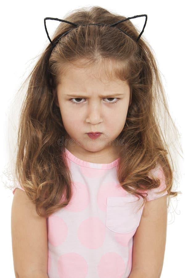 Da década europeia da aparência da menina olhares severos irritados imagem de stock