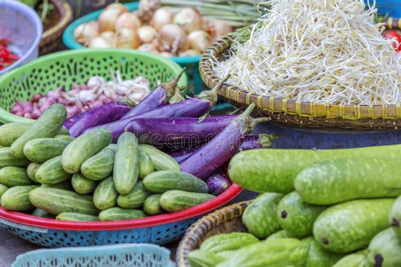 Da Lat market, Da Lat city, Lam province, Vietnam. Cucumber, aubergine, bean sprouts in vegetables stall in Da Lat market, Da Lat city, Lam province, Vietnam. Da royalty free stock photos