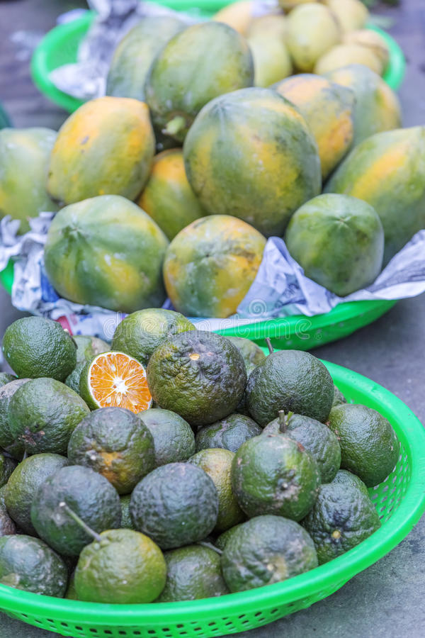 Da Lat market, Da Lat city, Lam province, Vietnam. Oranges and papayas in fruit stall in Da Lat market, Da Lat city, Lam province, Vietnam. Da Lat is called the royalty free stock photo