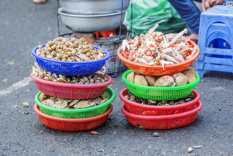 Da Lat market, Da Lat city, Lam province, Vietnam. A pedlar of seafood in Da Lat market, Da Lat city, Lam province, Vietnam. Da Lat is called the city of flower stock photos
