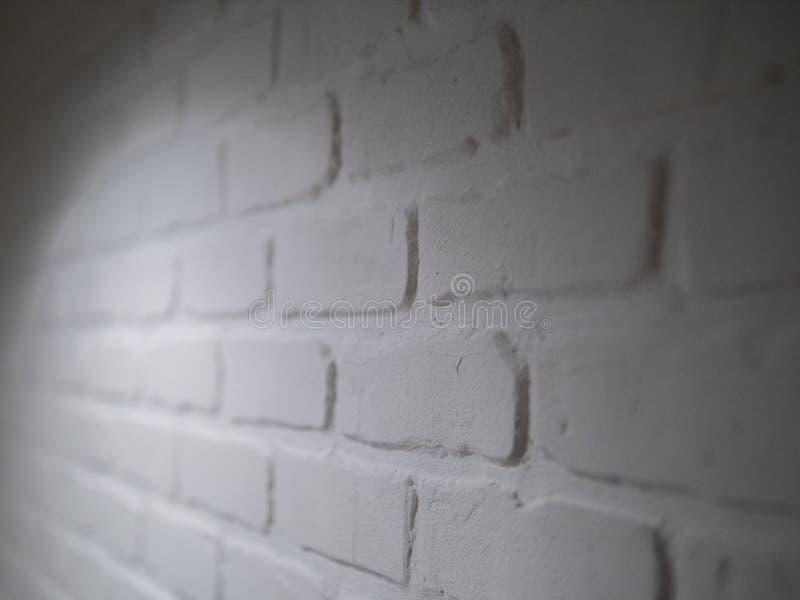 Da luz velha do estuque do teste padrão de pedra abstrato do tijolo da textura do papel de parede fundo branco cinzento e envelhe imagens de stock
