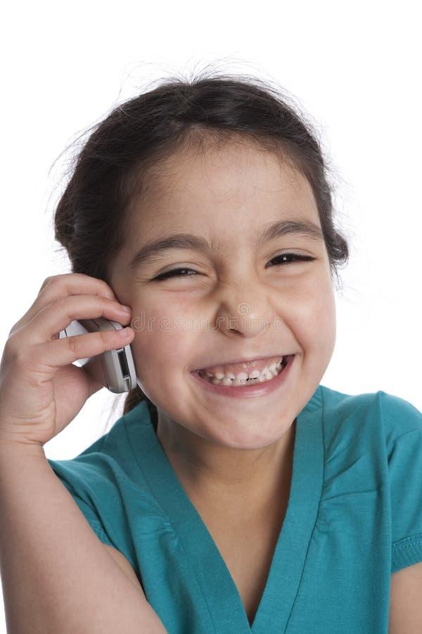 IS-IS da menina que escuta seu telefone móvel foto de stock