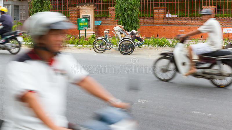 DA NANG, VIETNAM, 31 JULY 2012. Sleeping cyclo driver in it's ow royalty free stock photo