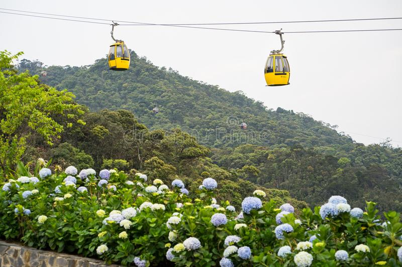 Da Nang, Vietnam - Apr 2, 2016: Cable car with flowers on foreground for transportation to Ba Na Hills site, 30km from Da Nang cit. Y royalty free stock photos
