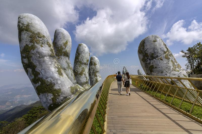 Da Nang, Vietnam - October 31, 2018: Tourists in Golden Bridge, a pedestrian footpath lifted by two giant hands, open in July 2018 royalty free stock photography