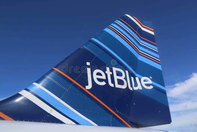 Da tailfin ispirato da codice a barre di progettazione di JetBlue Embraer 190 immagine stock libera da diritti