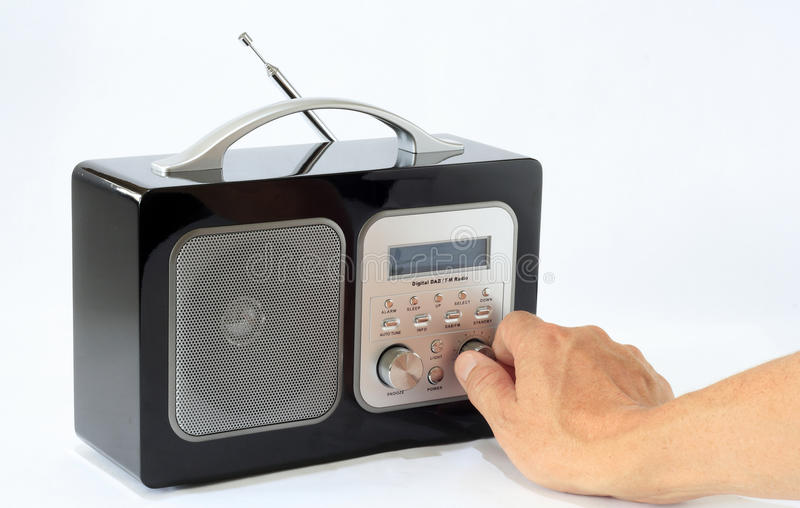DAB Radio. Male turn on and cease its DAB radio to hear music royalty free stock photography