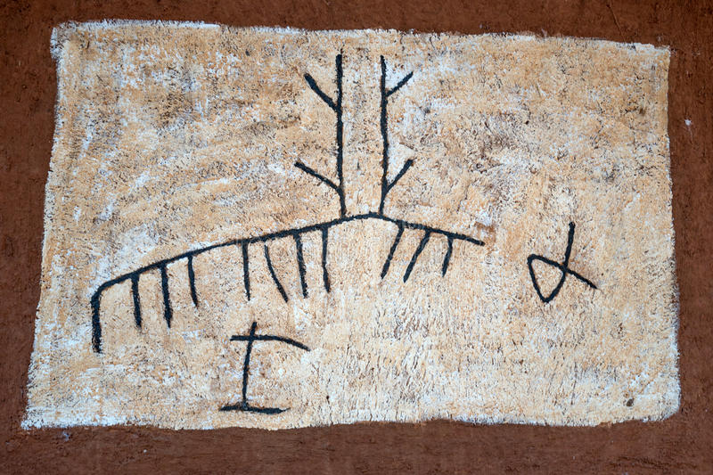 DABANA, SRI LANKA - CIRCA DECEMBER 2016: Vedda men. Tribal drawings and symbols. Veddas are an indigenous people of Sri Lanka living in tribes in the jungle stock images