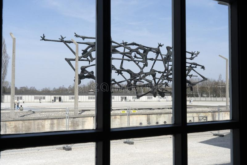 Dachau, German : April 2, 2019- Dachau memorial sculpture inspired by emaciated bodies of prisoners and barbed wire fences. Dachau royalty free stock photography