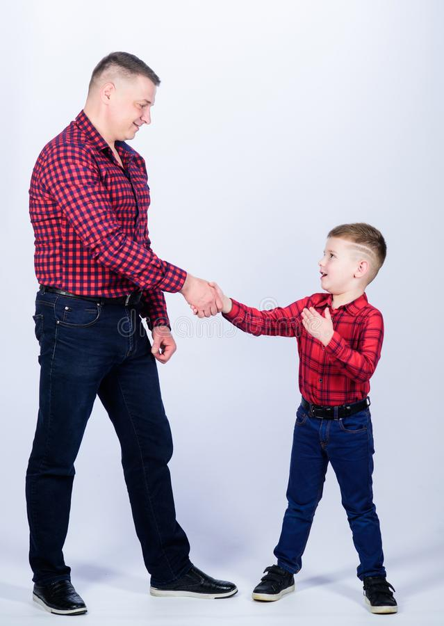 Dad and adorable child. Parenthood concept. Fathers day. Father example of noble human. Cool guys. Father little son red royalty free stock photo