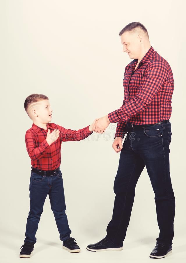 Dad and adorable child. Parenthood concept. Fathers day. Father example of noble human. Cool guys. Father little son red royalty free stock photos